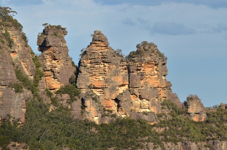 wales: Landscape of The Three Sisters rock formation in the Blue Mountains of New South Wales, Australia, on the north escarpment of the Jamison Valley at sunset.