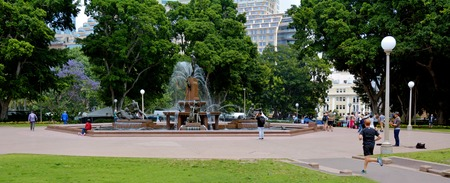 unrecognisable people: Panoramic landscape view of Archibald Fountain in Hyde Park, the oldest public parkland in Australia located in Sydney New South Wales Australia Editorial