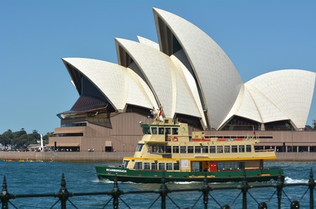 port jackson: The Opera House with a ferry that sails out from Circular Quay towards Sydney harbour in Sydney, Australia. Editorial