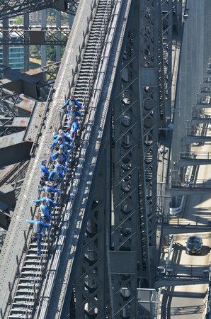 harbours: SYDNEY, AUS  - OCT 18 2016: People climb on Sydney Harbour Bridge in Sydney Australia.The Sydney Harbour Bridge is the world�s largest steel arch bridge. Editorial