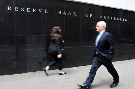 SYDNEY - OCT 20 2016:Business people pass by the Reserve Bank of Australia. Its the Australian central bank and banknote issuing authority since 1960 when it replaced the Commonwealth Bank functions.