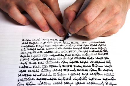 Hands of Sofer writes a sefer Torah. In the Torah's 613 commandments,