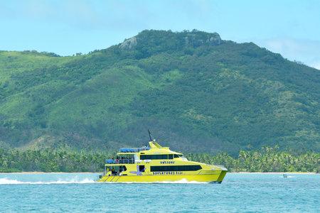 FIJI - DEC 20 2016: The bright yellow and fast catamaran, Yasawa Flyer, Fiji. Its a famouse high speed ferry transfers between the main island on Fiji and Yasawa & Mamanuca Island resorts.