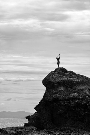 Silhouette of Fijian man stands on a sea cliff in the Yasawa Islands of Fiji. Travel Fiji concept,  copy space (BW)