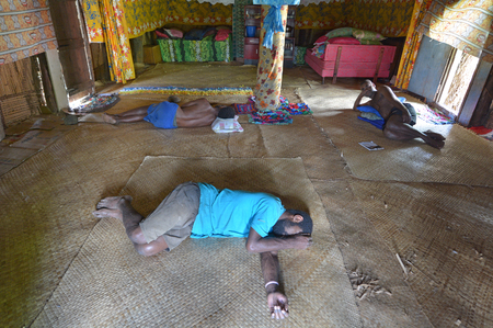 sleepiness: BA, FIJI -  DEC 30 2016:Indigenous Fijian men lay wasted on the floor after drinking lots of Kava. Some of the side effects of kava are headache, dizziness, drowsiness, depression and sleepiness.