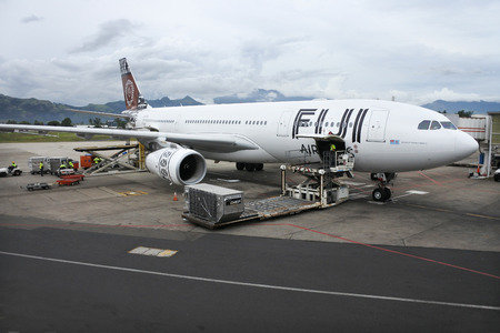 two and two thirds: NADI, FIJI - DEC 11 2016:Fiji Airways Boeing 737-800 in Nadi International Airport, Fiji.Fiji Airways annually transports almost two-thirds of the visitors to Fiji Island country.