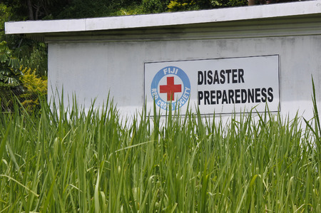 cruz roja: SAVUSAVU, FIJI - JAN 19 2017:Fiji Red Cross Disaster Preparedness. Since Cyclone Winston made landfall in Fiji on February 20th, the Fiji Red Cross has been able to reach 63,000 people with emergency relief. Editorial