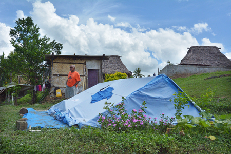 unicef: BA, FIJI -  DEC 30 2016:Victim of Cyclone Winston live in UNICEF tent in Navala village. Fiji struggles to rebuild a year after Cyclone Winston tropical storm devastated the country on February 2016. Editoriali