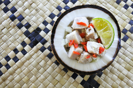 Flat lay view of Fijian Food, Kokoda (Raw Fish Salad). Kokoda is Fijis version of ceviche, enriched with coconut milk to balance out all the acid.