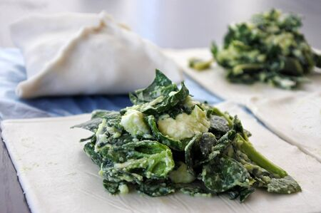 cousin: Uncooked bourekas with kashkaval cheese and spinach. Food background . copy space Stock Photo