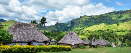 Panoramic view of Fijian bures in Navala village in the Ba Highlands of northern-central Viti Levu, Fiji. It is one of the few settlements in Fiji which remains fully traditional architecturally. Reklamní fotografie