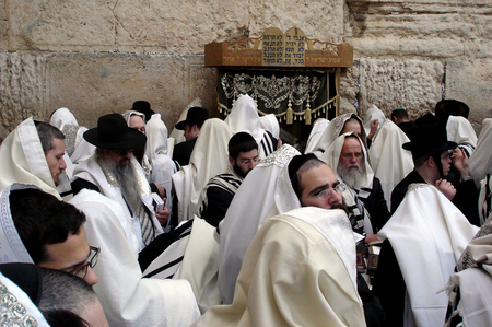 JERUSALEM - APRIL 07: Orthodox Jewish men Pray at the Western Wall during the Jewish holiday of Passover in Jerusalem, Israel. Passover commemorates the liberation of the Israelites from Egyptian slavery Editorial
