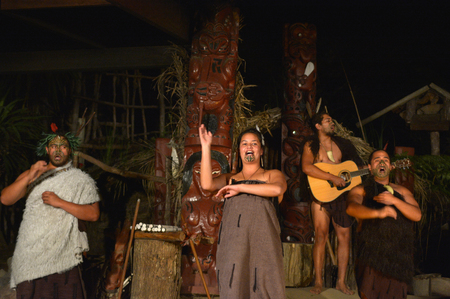 migrated: ROTORUA, NZL - APR 25 2017:Maori people sing and dance. Maori are the indigenous people of New Zealand that migrated to New Zealand from Polynesia1000 years ago.