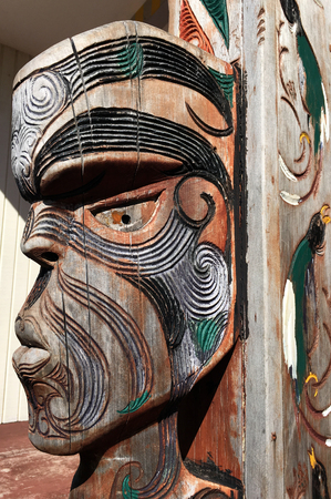 AUCKLAND - APR 08 2017:Figure of a Maori male face. Maori culture of is a rich tradition carried out for 1000s of years in New Zealand. Editorial