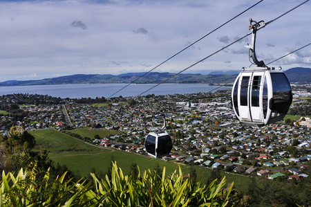 Riding cable car above Rotorua lake and city, in the centre of North Island of New Zealand