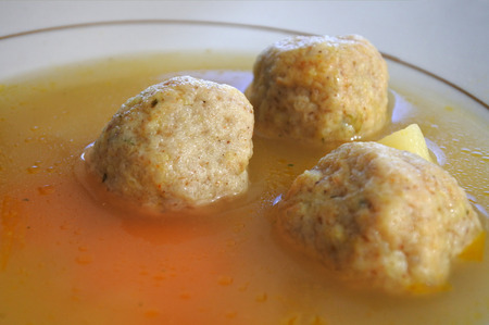 Matzah balls, Ashkenazi Jewish soup dumpling made from a mixture of matzah meal, eggs, water and chicken fat served on Passover Jewish Holiday.Food background and texture Stock Photo