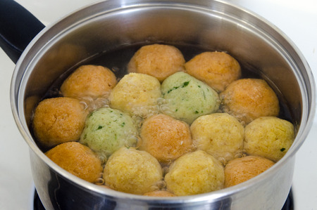 Matzah balls in a pot of soup during the Jewish holiday of Passover - Pesach.