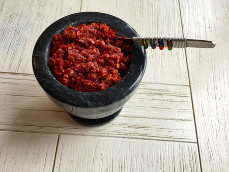copy paste: Lunumiris, a spicy Sri Lankan sambal paste served as a condiment consists of chili pepper, red onions, Maldive fish, sea salt, black pepper and lime juice. Food background and texture. Copy space Stock Photo