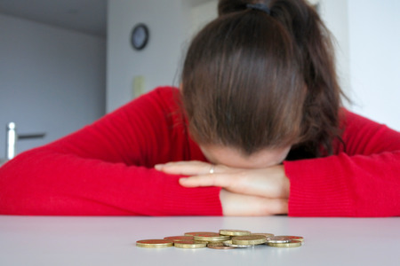 Young woman mother (age 30-40) having financial problems. Money concept.  Real people. Copy space