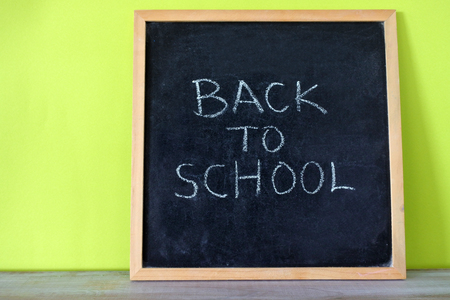 Back to school sign. Blackboard with text reading Back to School. Child Education concept. Copy space