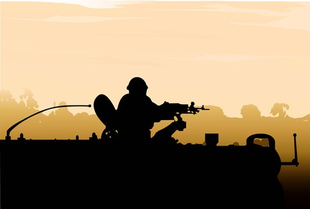 incursion: Silhouette of an army soldier preparing his tank and weapons at sunset