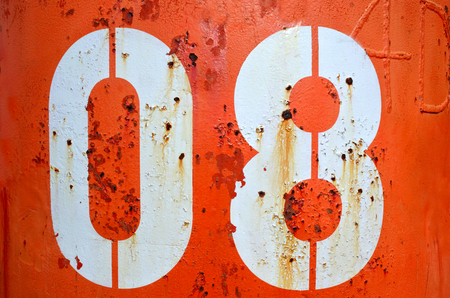 The number eight 08 on red metal container. Stock Photo