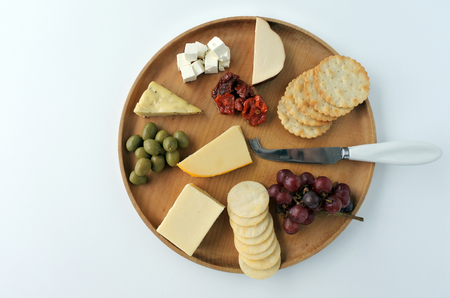 Flat lay view of cheese platter with red wine. Food background and texture. Copy space
