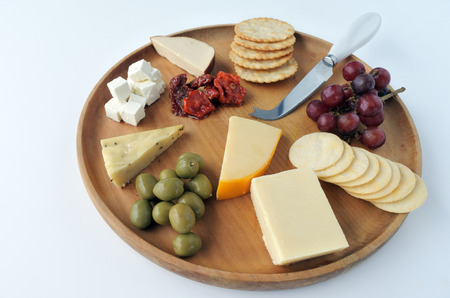 Overhead view of cheese platter with red wine. Food background and texture. Copy space