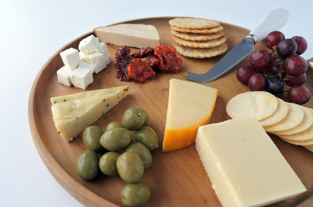 tabla de quesos: Cheese platter with red wine. Food background and texture. Copy space