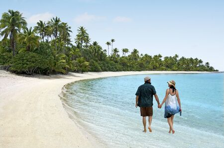 Couple Walk on One foot Island in Aitutaki Lagoon Cook Islands. Real people. Copy space