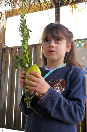 hadas: Jewish girl (age 07) blessing on the four spices on Sukkot Jewish Holiday.