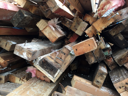 Trash lumber background. Old plank from demolition of the wooden house.