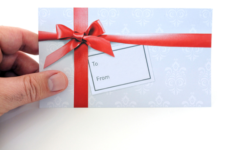 Man holds a gift card. Holidays concept. Copy space. Stock Photo