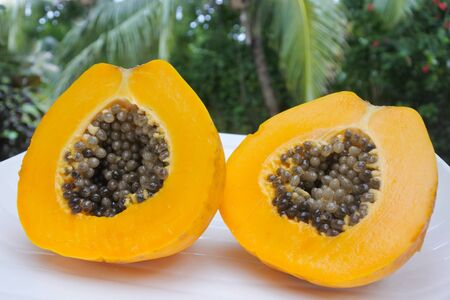 Open Papaya fruit served on a plate. Food background and texture. Copy space Stock Photo