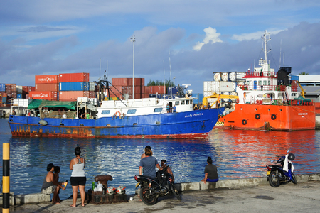 RAROTONGA - JAN 14 2018:Cook Islanders welcoming a small Inter-island ferry boat with their relatives onboard in Port of Avatiu.Cooks Islands reef passages are too narrow for large passengers ships.