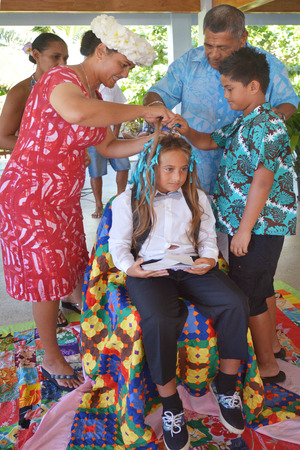 RAROTONGA - DEC 29 2017:Haircutting ceremony in Cook Islands began when missionaries arrived but in pre-Christian world Maori belief that growing a boys hair long ensured he survived beyond infancy.
