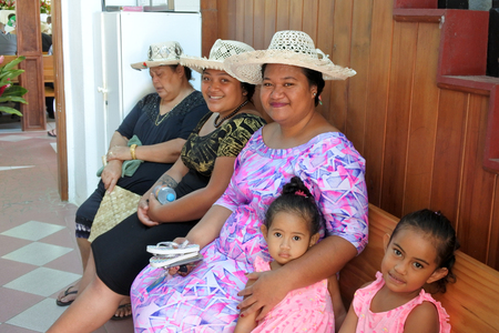 RAROTONGA - DEC 18 2017:Cook Islanders women pray at CICC church.94% of Cook Islanders (14,974) associated themselves with a faith.The Cook Islands Christian Church dominant with 49% (7,356) members.