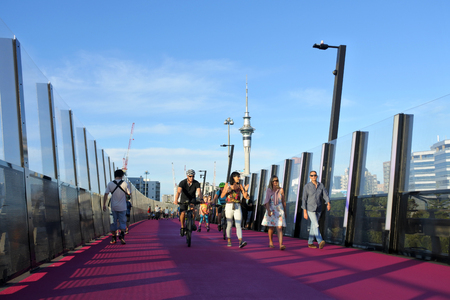 Auckland, New Zealand -  Dec 02 2017: Traffic on Aucklands pink Lightpath. In 2016 The World Architecture Festival announced Te Ara I Whiti as the winner of the transport category at it  at its annual awards in Berlin