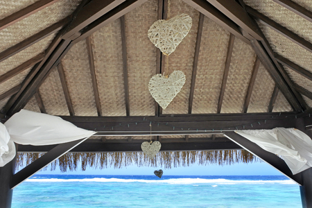 Panoramic tropical lagoon view from an outdoor Pacific Island romantic  overwater bungalow in Rarotonga, Cook Islands.