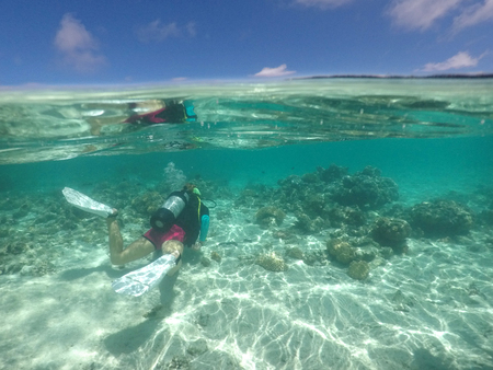 Person scuba dive in Rarotonga, Cook Islands. Real people. Copy space