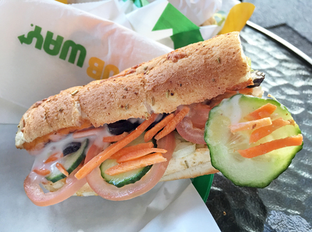 AUCKLAND - MAR 27 2018:SUBWAY sandwich on a table. It's the largest single-brand restaurant chain in the world with 43,035 restaurants in 108 countries Editorial