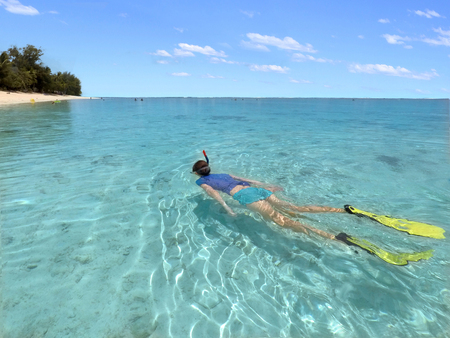 Young woman snorkelling  in a lagoon in Rarotonga, Cook Islands. Real people. Copy space Stock Photo