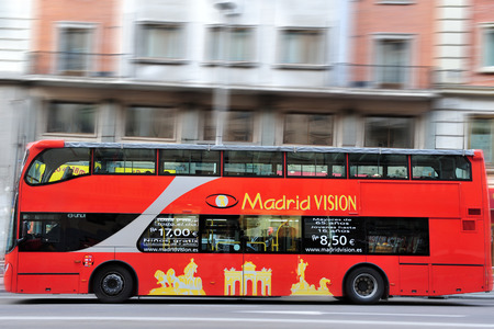 MADRID - MAR 01 2010: Motion blurr of Hop-on Hop-Off Panoramic Bus Tour servise on the Gran Via, Madrid's High Street Spain.