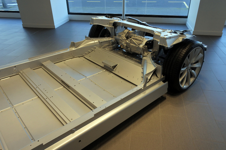AUCKLAND - AUG 12 2018:Above view of Tesla plug-in electric car chassis and battery. Since 2003 Tesla is accelerating the worlds transition to use  sustainable energy especially with its innovative electric cars.