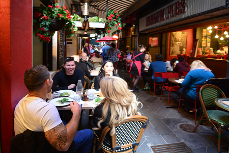 MELBOURNE - APR 13 2014:Pedestrian and dinners at Melbourne cafe and restaurant Hardware Lane in Melbourne Victoria, Australia.