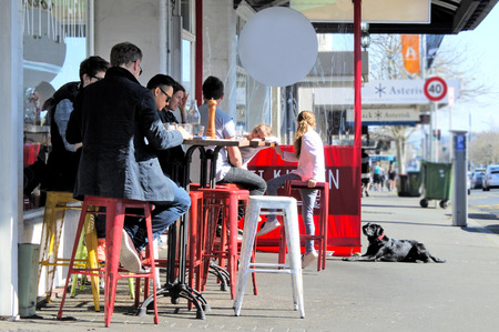 AUCKLAND - AUG 12 2018: People in a cafe in Ponsonby road. NZ is ranked the 13 highest consumer of coffee in the world, drink on average 2.5 cups per week, Higher than the USA and Australia.