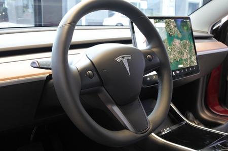 AUCKLAND - AUG 28 2018:The insignia of Tesla on the wheel of the plug-in electric car Model 3, a mid-size / compact executive luxury four-door sedan manufactured and sold by Tesla, Inc.
