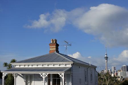 Victorian house against Auckland city skyline in Auckland New Zealand.
