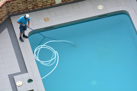 Aerial view of a pool cleaner cleaning a pool.