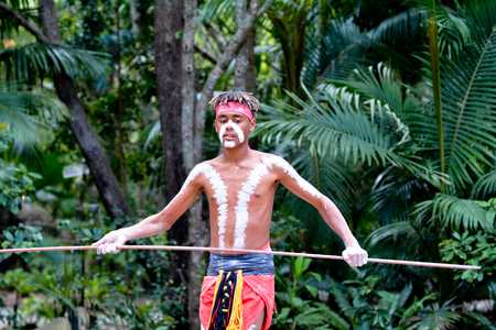 Young adult Indigenous Australianman holding a spear in Queensland, Australia. Фото со стока